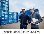 two engineers wearing hardhats... | Shutterstock . vector #1075208174