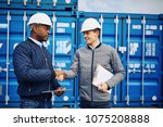 two smiling engineers wearing... | Shutterstock . vector #1075208888