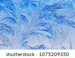 blue drawings on the glass in... | Shutterstock . vector #1075209350