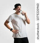 young rapper man smiling...   Shutterstock . vector #1075220960