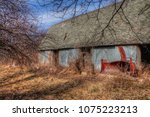an old neglected farm and... | Shutterstock . vector #1075223213
