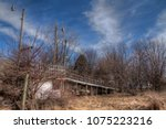 an old neglected farm and... | Shutterstock . vector #1075223216