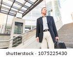 smiling senior businessman... | Shutterstock . vector #1075225430
