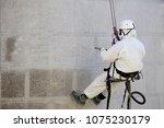 rope access facade maintenance  ... | Shutterstock . vector #1075230179