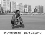 motivated black man taking a... | Shutterstock . vector #1075231040