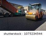 heavy asphalt paver red truck... | Shutterstock . vector #1075234544