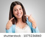 middle aged woman smiles ... | Shutterstock . vector #1075236860