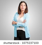 middle aged woman crossing his... | Shutterstock . vector #1075237103