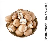 champignon mushrooms in bowl....   Shutterstock . vector #1075237880