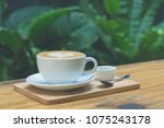 a cup of coffee with latte art... | Shutterstock . vector #1075243178