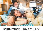 hippie couple with funny dog... | Shutterstock . vector #1075248179