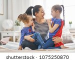 mother and her children playing ... | Shutterstock . vector #1075250870