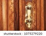 an antique bronze doorknob....   Shutterstock . vector #1075279220