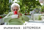 elderly old woman with injured... | Shutterstock . vector #1075290314