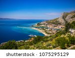 town omis with mountains ... | Shutterstock . vector #1075295129
