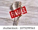 fragile stamp on a delivery pack   Shutterstock . vector #1075299563