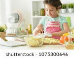 girl cook delicious to eat | Shutterstock . vector #1075300646