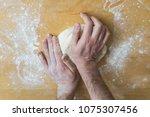 preparing pizza dough in a... | Shutterstock . vector #1075307456