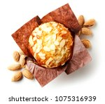 almond muffin in brown paper... | Shutterstock . vector #1075316939