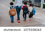 mother and pupil and kids... | Shutterstock . vector #1075338263