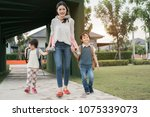 mother and pupil and kids... | Shutterstock . vector #1075339073