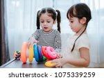 children girls play a toy games ... | Shutterstock . vector #1075339259