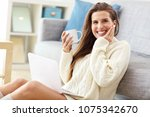 happy woman relaxing at home... | Shutterstock . vector #1075342670
