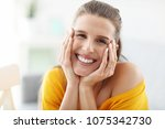 happy woman relaxing at home | Shutterstock . vector #1075342730