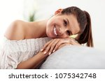 happy woman relaxing at home | Shutterstock . vector #1075342748