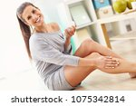 woman using body lotion on her... | Shutterstock . vector #1075342814
