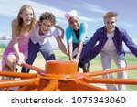 group spinning roundabout | Shutterstock . vector #1075343060