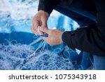 fisherman fixing a fishing net...