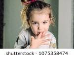a little happy girl with brown... | Shutterstock . vector #1075358474