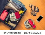 a suitcase with things and a... | Shutterstock . vector #1075366226