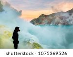 tourist in the crater of a... | Shutterstock . vector #1075369526