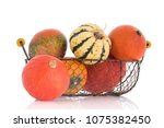 orange and green pumpkins in... | Shutterstock . vector #1075382450