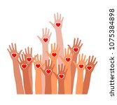 raised hands with heart icon.... | Shutterstock .eps vector #1075384898