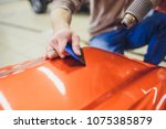 car wrapping specialist putting ... | Shutterstock . vector #1075385879