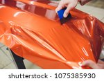 car wrapping specialist putting ... | Shutterstock . vector #1075385930
