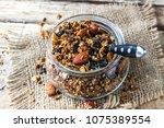 homemade granola in glass jar... | Shutterstock . vector #1075389554