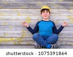portrait of a cute cheerful boy ... | Shutterstock . vector #1075391864