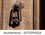 an antique bronze doorknob....   Shutterstock . vector #1075394324