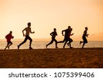 group of young people runs at... | Shutterstock . vector #1075399406