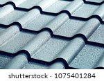 metallic roof with drops of... | Shutterstock . vector #1075401284