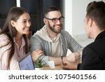 excited smiling millennial... | Shutterstock . vector #1075401566