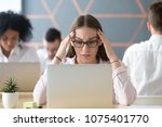 stressed young female student... | Shutterstock . vector #1075401770