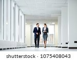 confident business colleagues... | Shutterstock . vector #1075408043