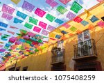 colorful paper flags over street | Shutterstock . vector #1075408259