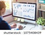 businessman analyzing business... | Shutterstock . vector #1075408439