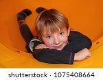 portrait of smiling little boy... | Shutterstock . vector #1075408664